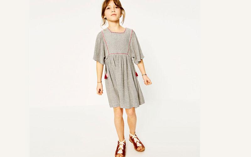 pompones en la ropa de niños